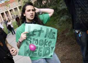 A woman holds a sign at a pro-marijuana rally at the University of Colorado in Boulder